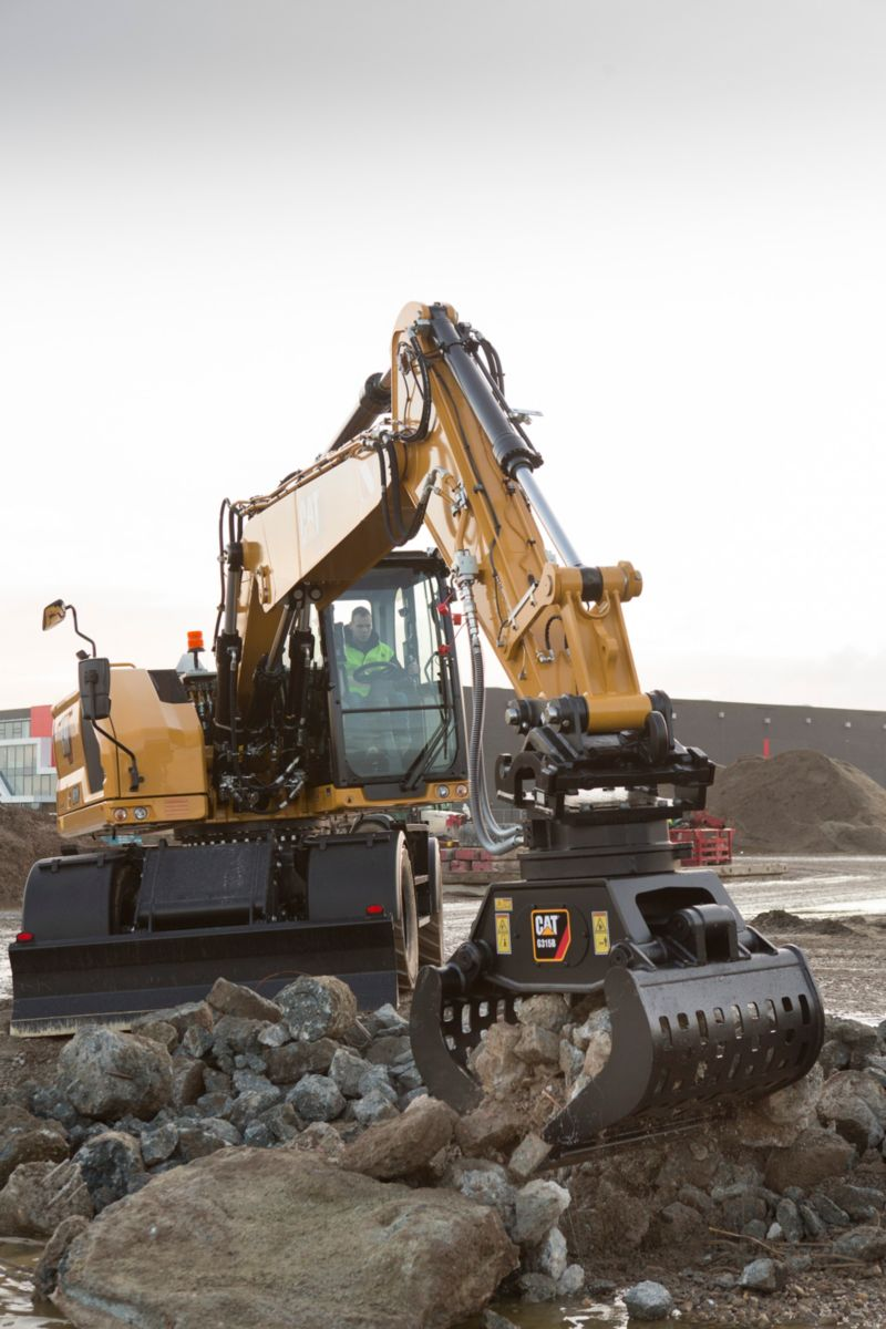 Tackle rocks with the grapple on the M318 Wheeled Excavator