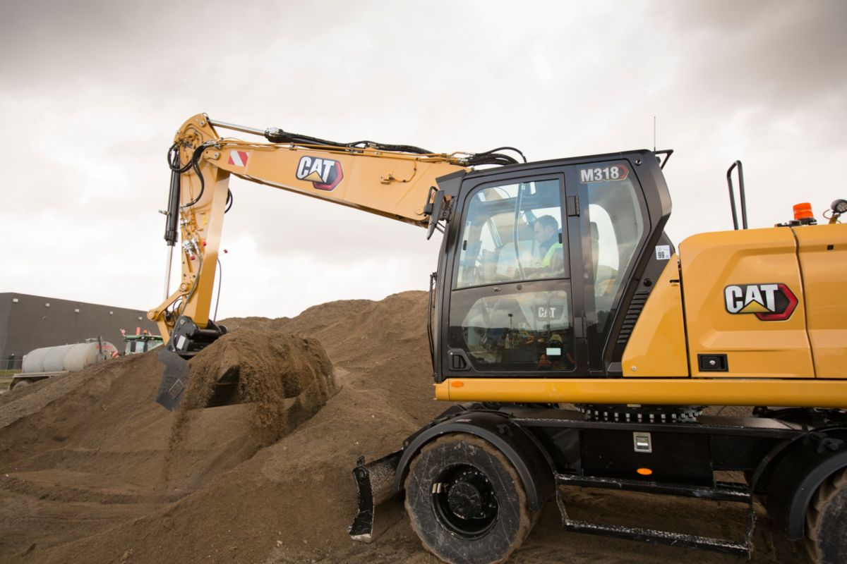 Quickly load trucks with the M318 Wheeled Excavator